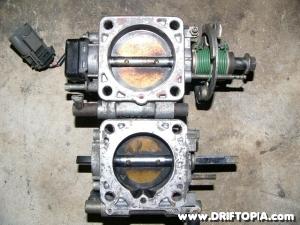 The KA24DE throttle body and the CA18DET throttle body side by side.