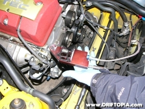 the oil feed/ mounting bracket is installed between the vtec solenoid and the head on the comptech supercharger s2000.