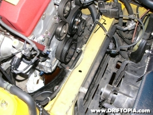 Image showing the dented cross-member required to clear the oil drain on the comptech supercharged s2000.