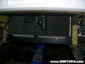 The ac condenser bracket reinstalled on the honda s2000