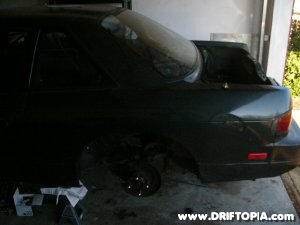 Side view of the removed tein coilovers from the rear suspension on the 240sx