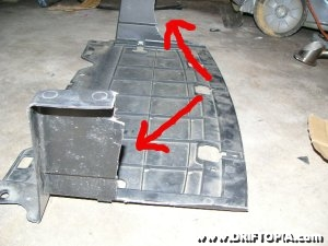 Jpg image of the front center skid plate cut to accommodate the fmic on the comptech supercharged honda s2000