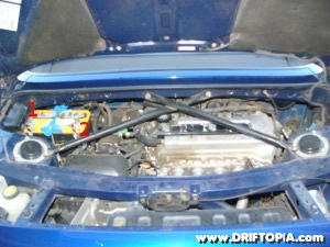 Remove the factory battery from the engine bay