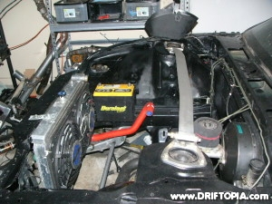 The battery has been relocated in the 240sx's engine bay for better weight distribution.