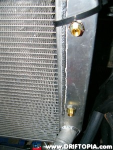 "The 1/8"" to 1/4"" adapters installed in the transmission cooler of the radiator."