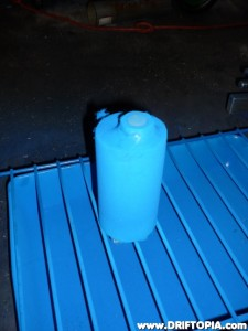 After a through cleaning and sanding, I decided to powdercoat the reservoir.  This image shows the coat media sprayed on.