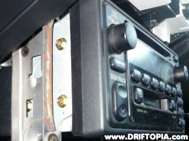 Side view of the factory head unit during removal.