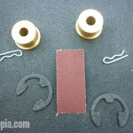 The Speed Source kit includes 2 bushings, 2 C-clipsm 2 retaining pins and sandpaper.