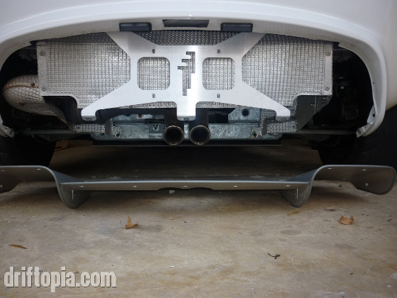 This image shows the rear panel eliminator from Sector111.  It is a light weight license plate holder that saves about 4.5 lbs in place of the stock panel.  It also allows more airflow through the rear end