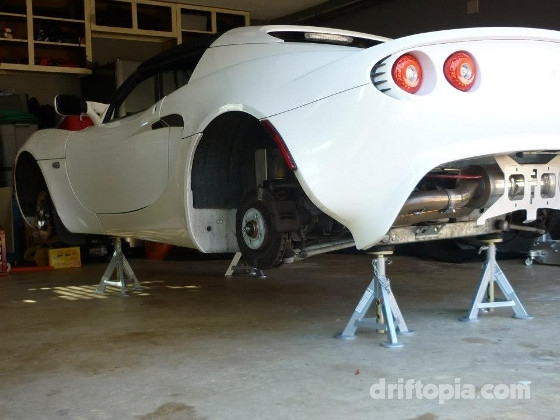 Alternate image of the Lotus Elise on jack stands.