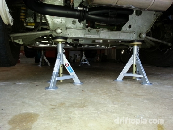 All four corners of the Lotus Elise lifted on jack stands.  Notice the positioning of points D on the subframe.
