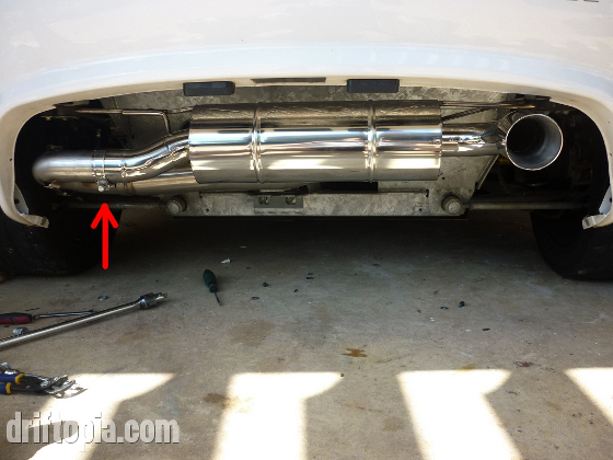 Tighten the exhaust clamp after mounting the muffler via the exhaust hangers.