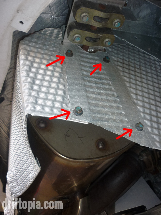 There are two access panels (one per side) that must be removed from the stock muffler's heat shield.