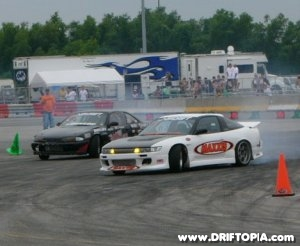 Image of two professional drifters racing at NOPI drift.