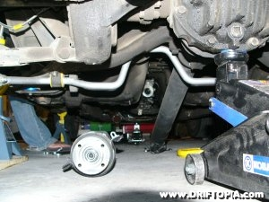 Image showing the two piece driveshaft removed from a Nissan 240sx making way for the engine removal.