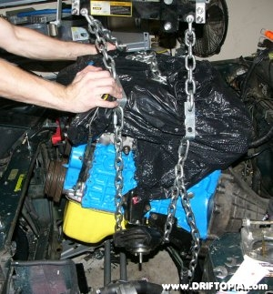 Image showing the ca18det motor being removed from the engine bay.