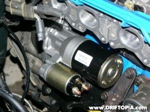 The new starter from a 1986 Nissan 200sx installed on the ca18det.