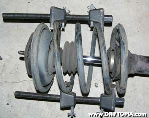 The front spring compressed.