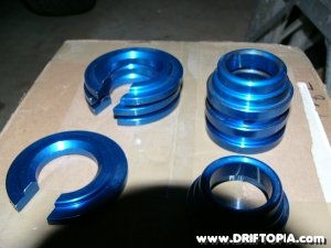 Image showing the anodized blue subframe spacer kit
