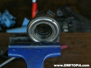 Using a table clamp to remove the old throwout bearing